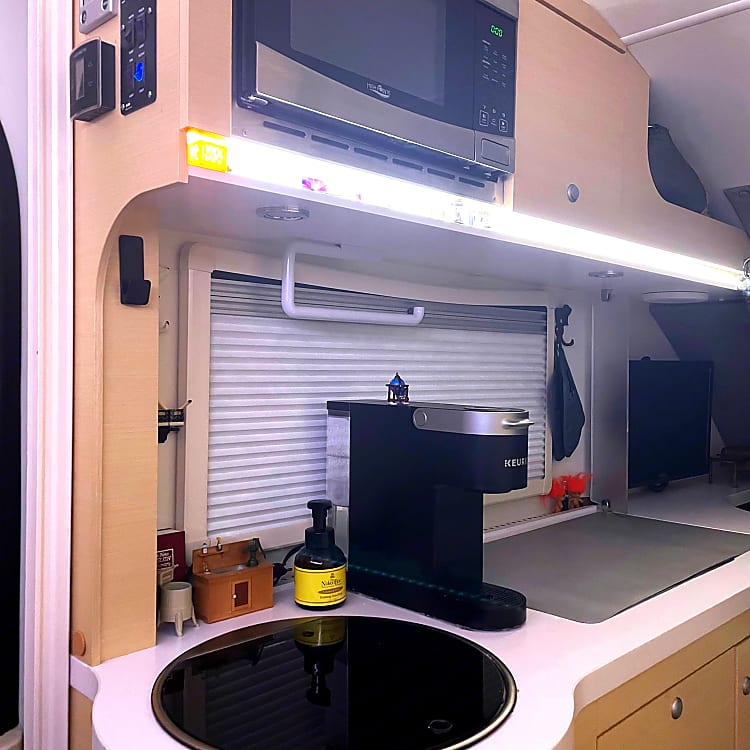Kitchen: Coffee, sink and two burner propane stove and microwave Lots of storage