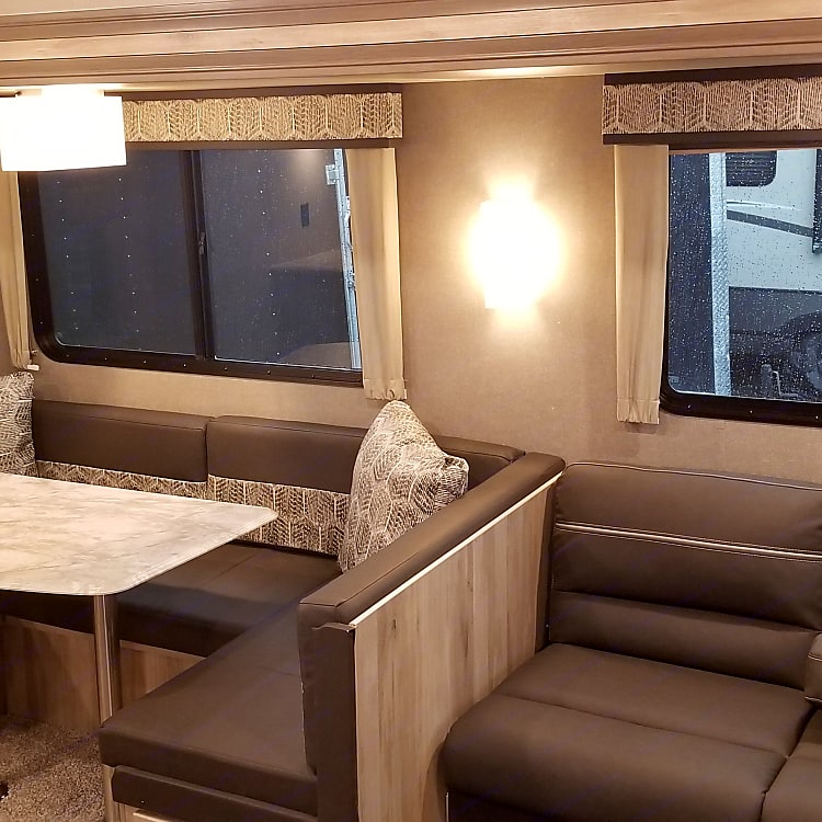 convertible dinette and couch fold into extra beds, large storage under dinette