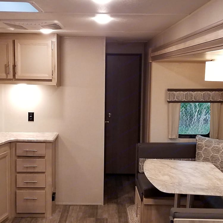 fully stocked kitchen, dinette, lots of windows, skylights, and storage