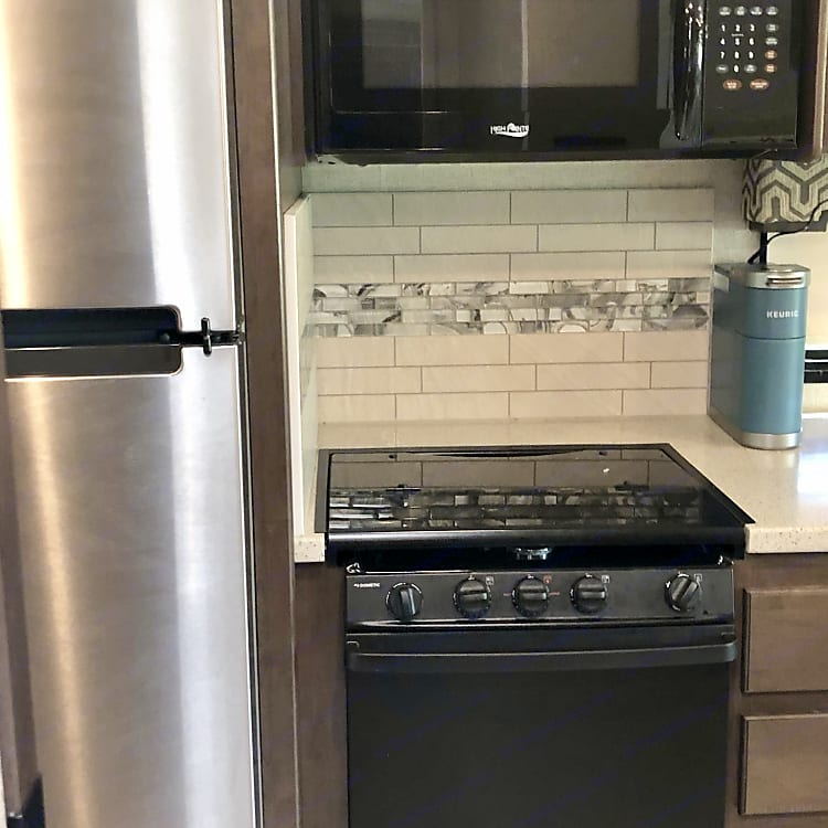 You'll love the kitchen with an 11 cu. ft. residential refrigerator with an ice maker and plus a pantry for all your dry goods.