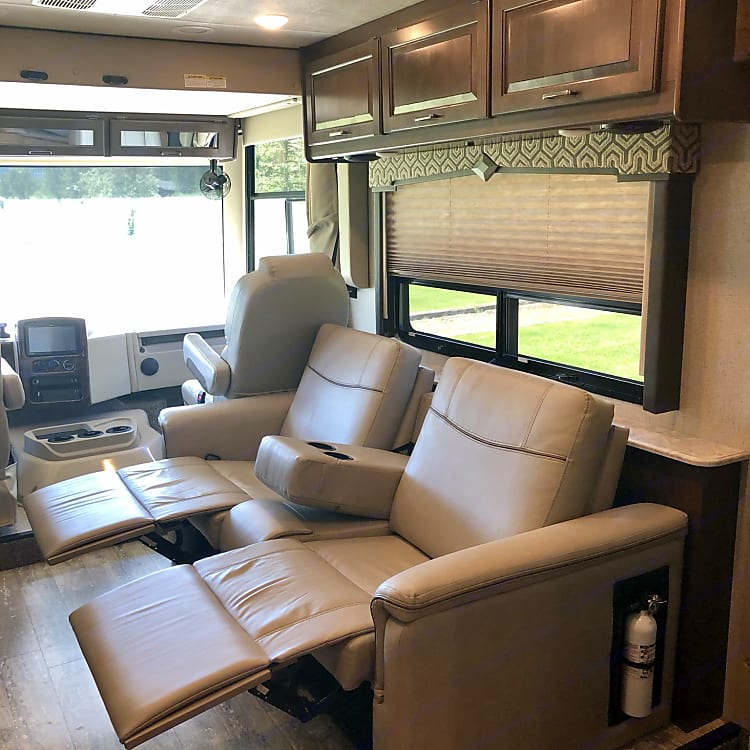 """This Thor Motorhome has a special touch with reclining chairs to watch your favorite movie on the 40"""" LED TV."""