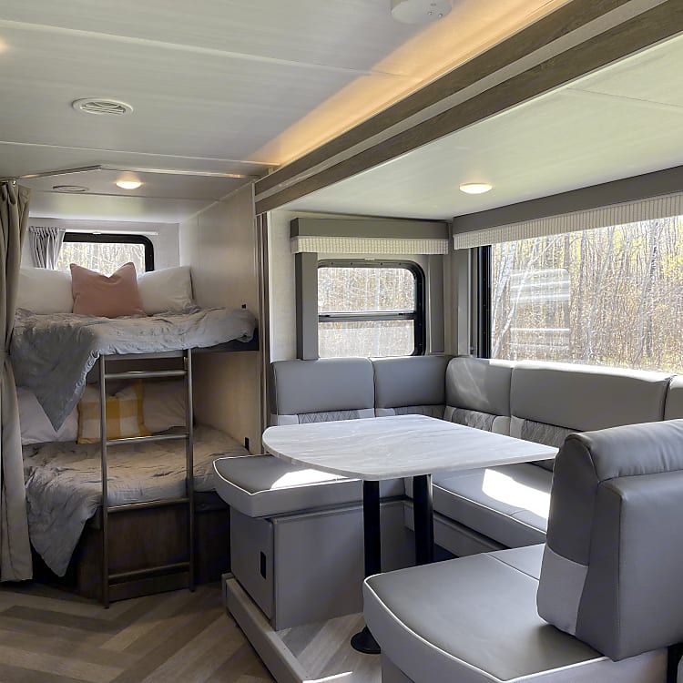 Enjoy a meal around the comfy dinette! You might even choose to fold the seating down into another full-sized sleeping space.