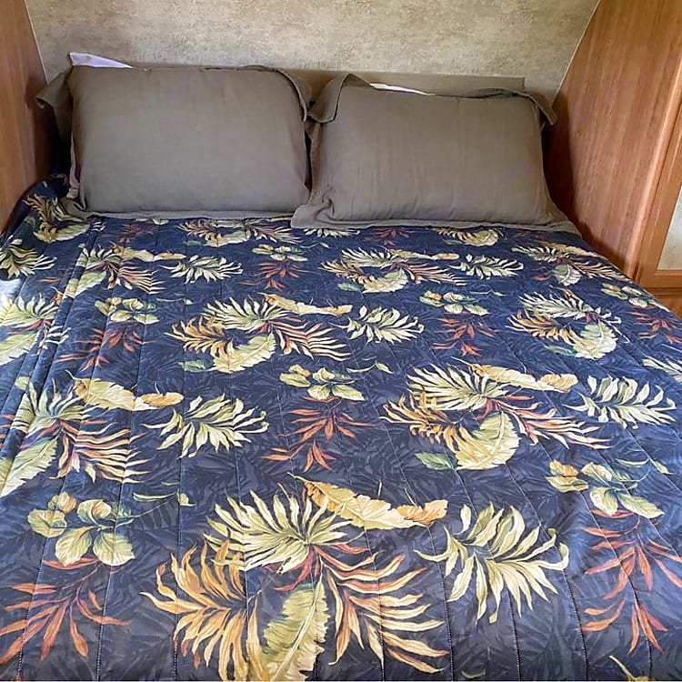 Very comfortable queen bed with custom, thick mattress