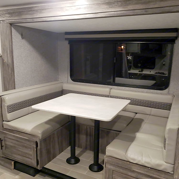 The U-dinette has ample space and a panoramic window.