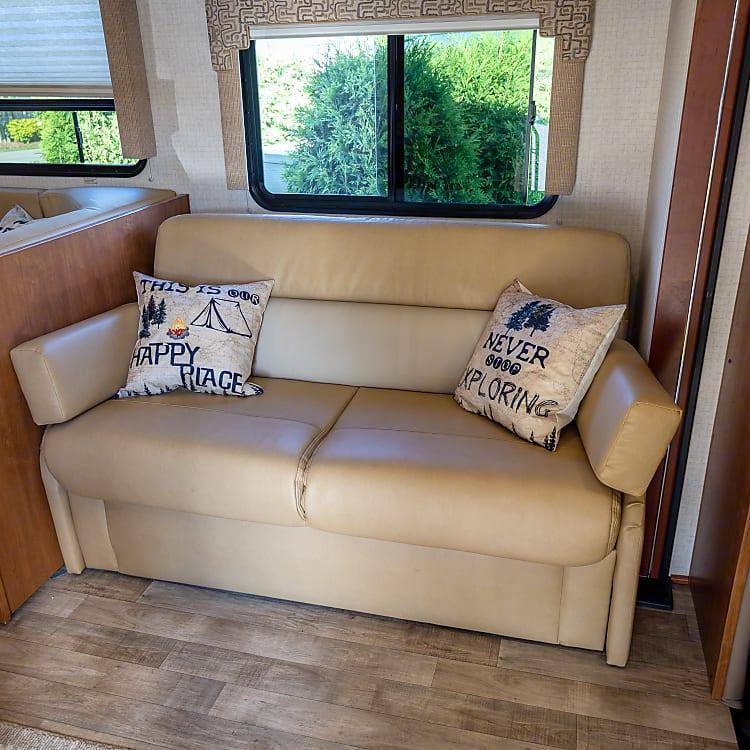 Sofa has a hide-a-way bed.