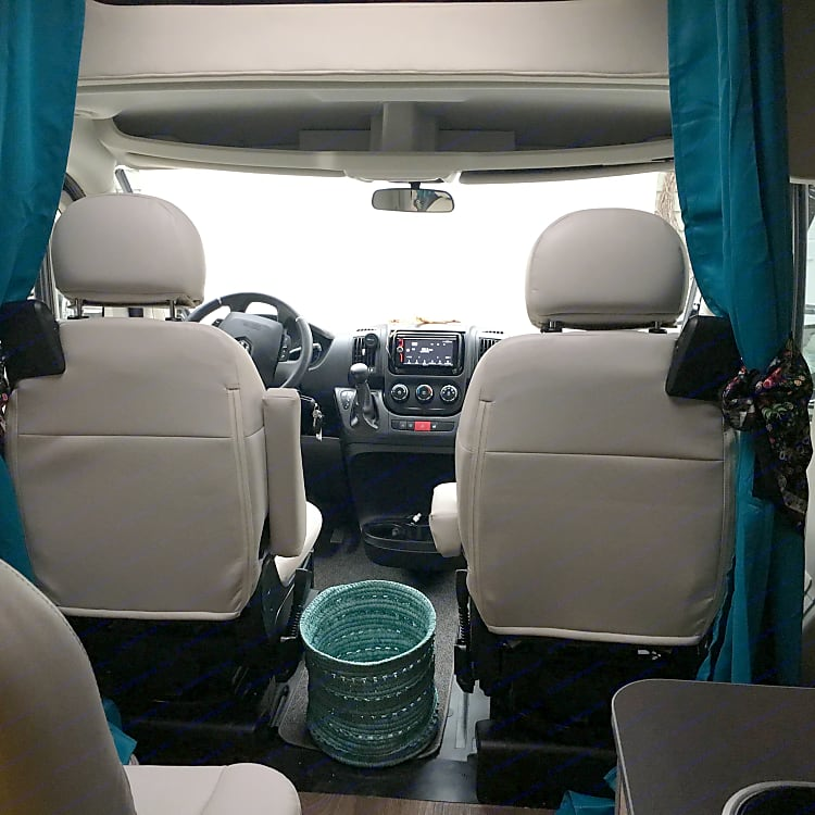 Excellent access from coach to front cabin.  Privacy curtain in addition to front window shades