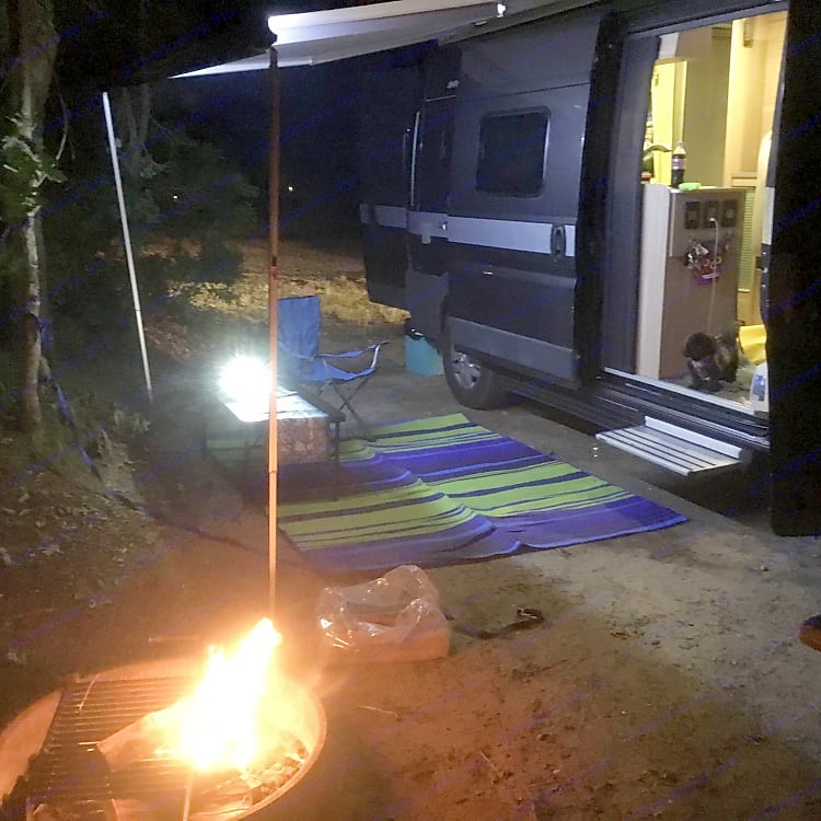 campfire and lighted awning in place for warm summer evenings. sliding door is screened