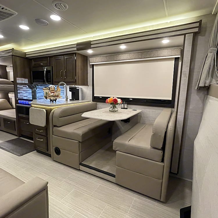 Dinette with 4 seat belts, kitchen and fold-out couch.