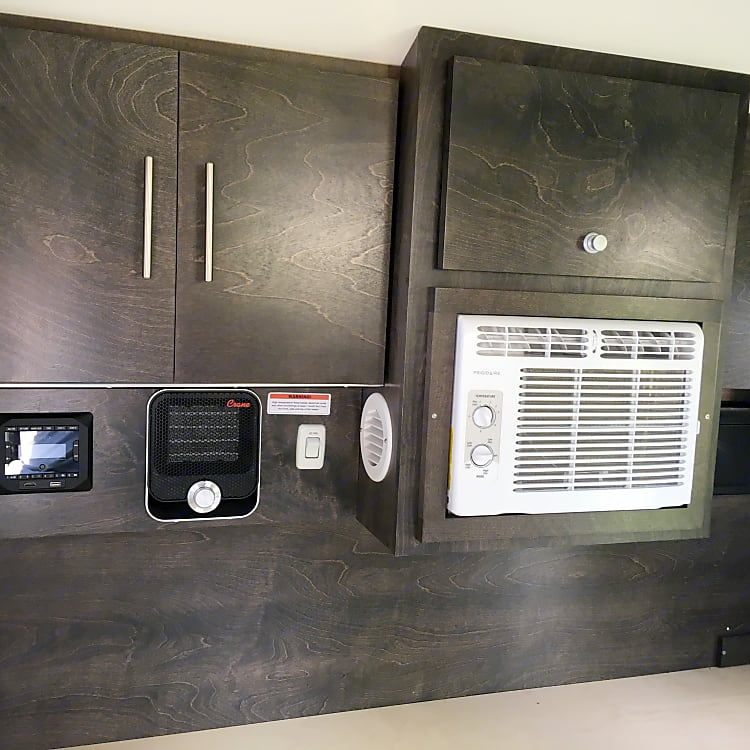 Storage cabinets (above), radio, heater, and AC.