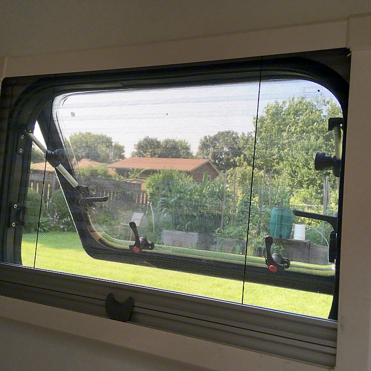 Side windows have a pull-down bug screen, or a pull-up shade/privacy screen.