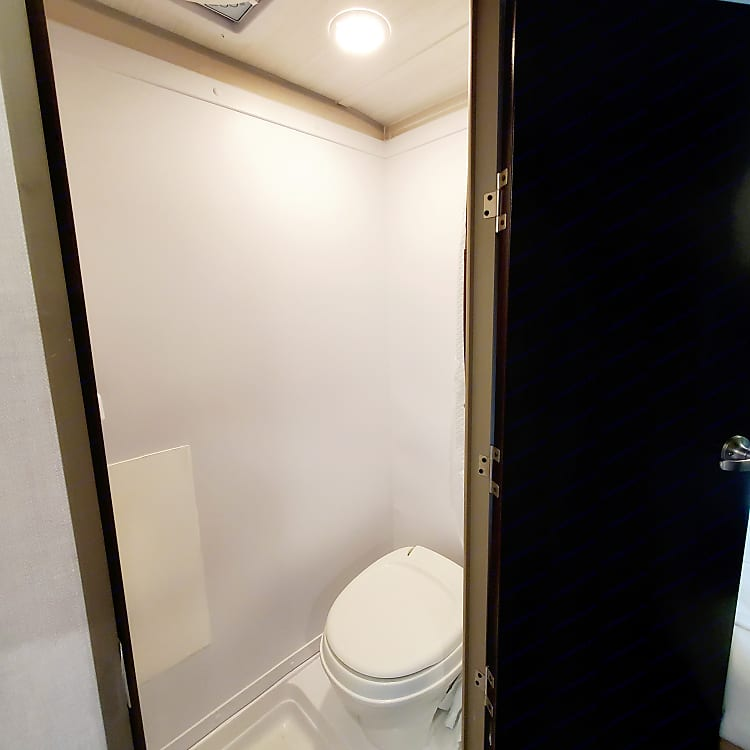 This is a small space but gets the job done. It is a toilet shower combo.