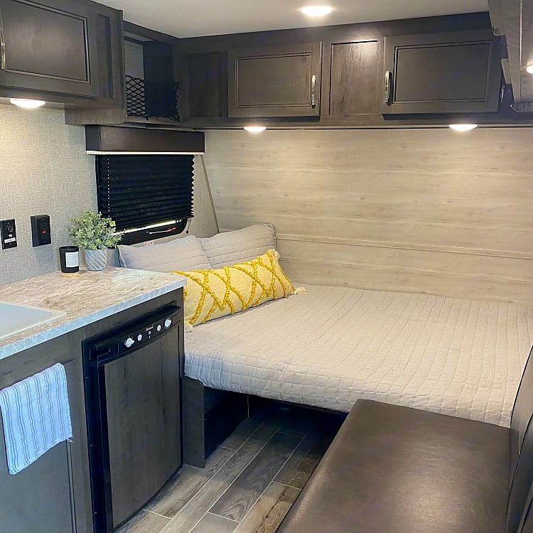 Dinette converts to a queen bed, sofa is across from kitchen