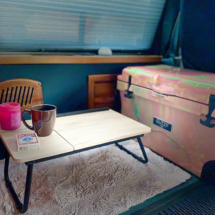 This cute bed table comes with every rental along with that super adorable cooler that can hold ice for days!