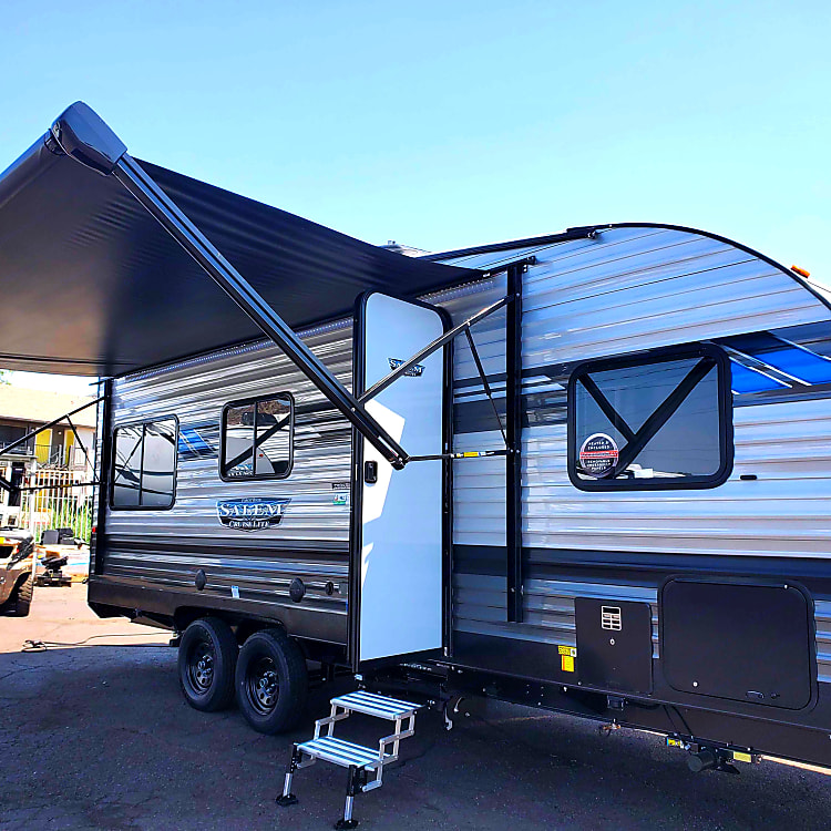 Sleek blue and gray design with a lights awning makes for a relaxing trip.