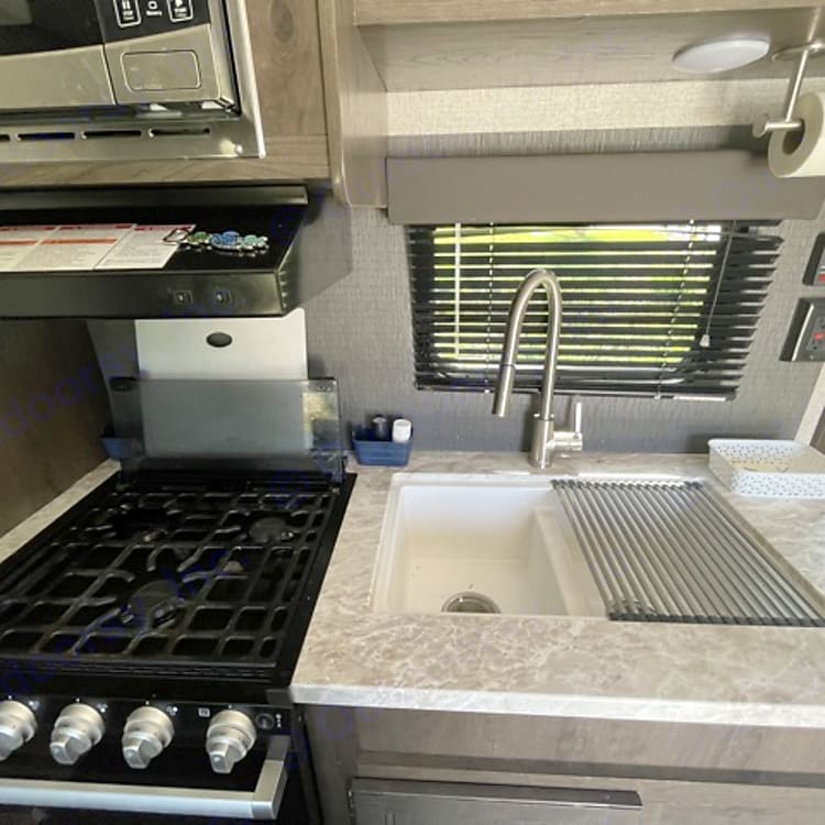 Full functioning sink, stove, oven, microwave, refrigerator, and freezer!