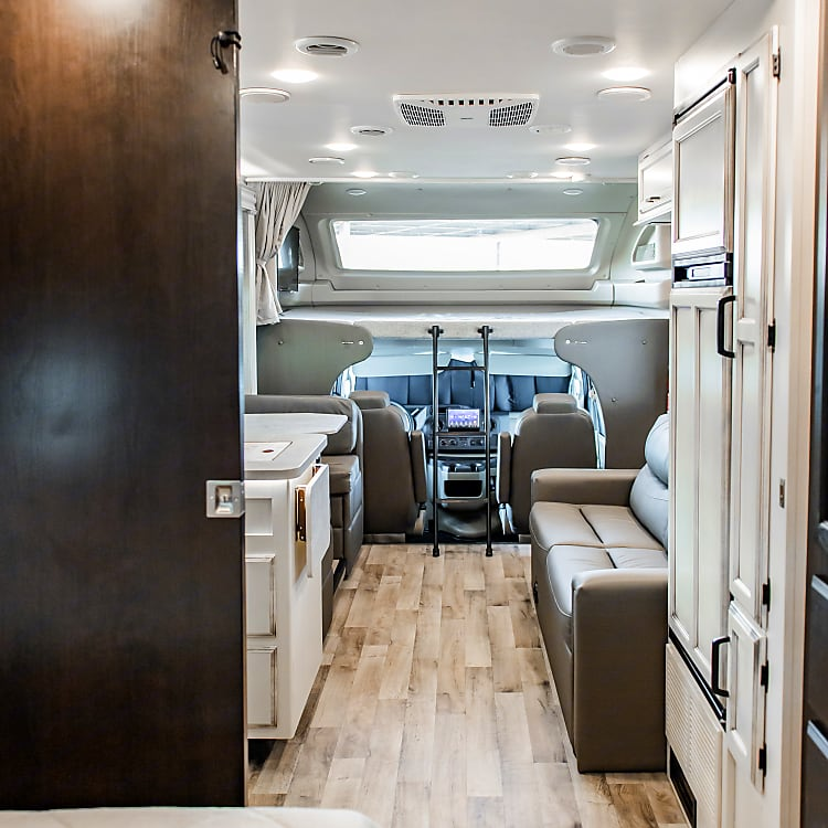 We love the view from the back bedroom to the front, where you can see the beautiful flooring, up to the nice long window above the cab bunk!
