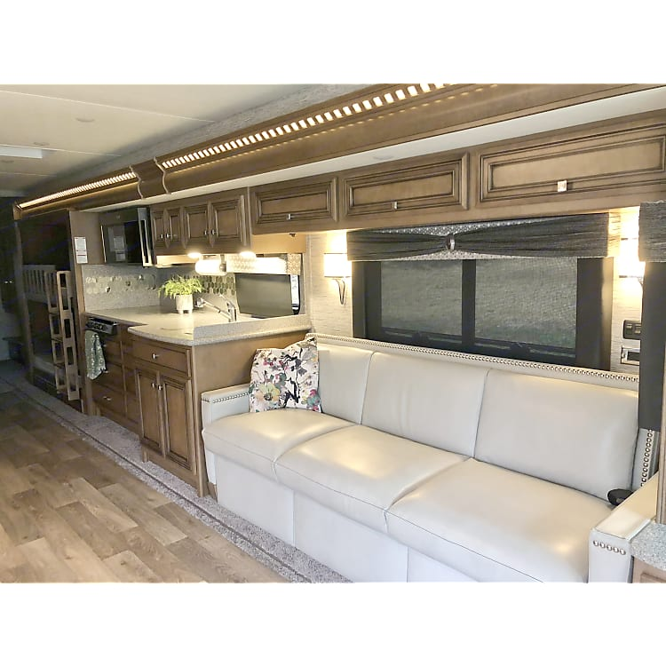 This couch is very comfortable and also unfolds into a bed. Our kitchen offers a stainless sink with two sides and quartz countertops. Stove & oven