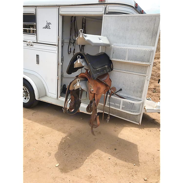 Offers a 3-tier swivel saddle rack and two large and lengthy storage compartments.