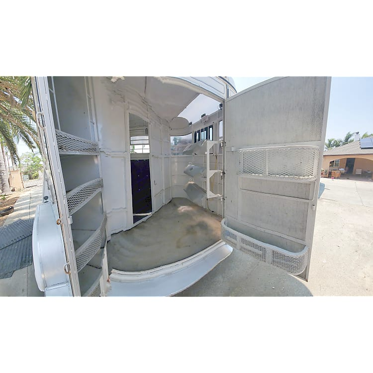 Offers organized corner storage, carpeted flooring, bridle hooks, high center mounted switch light, and latching cargo door.
