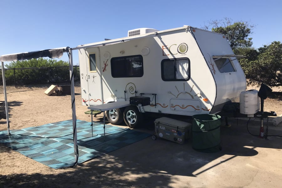 The trailer has Thule attachable table and BBQ grill and outside shower.  Also large ground mat