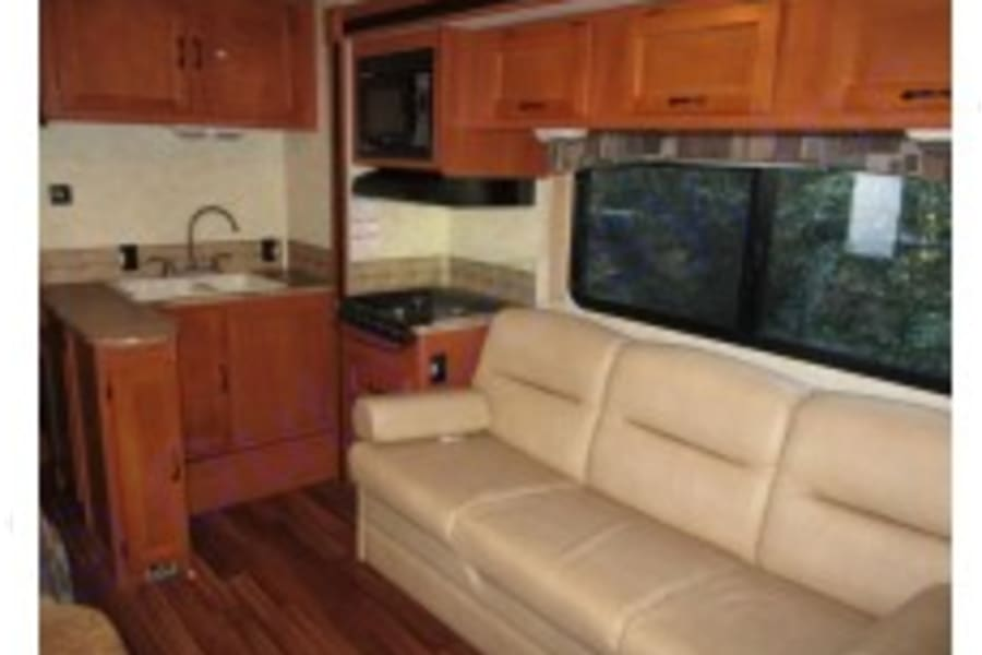 Comfortable kitchen, one slide out, couch converts to bed