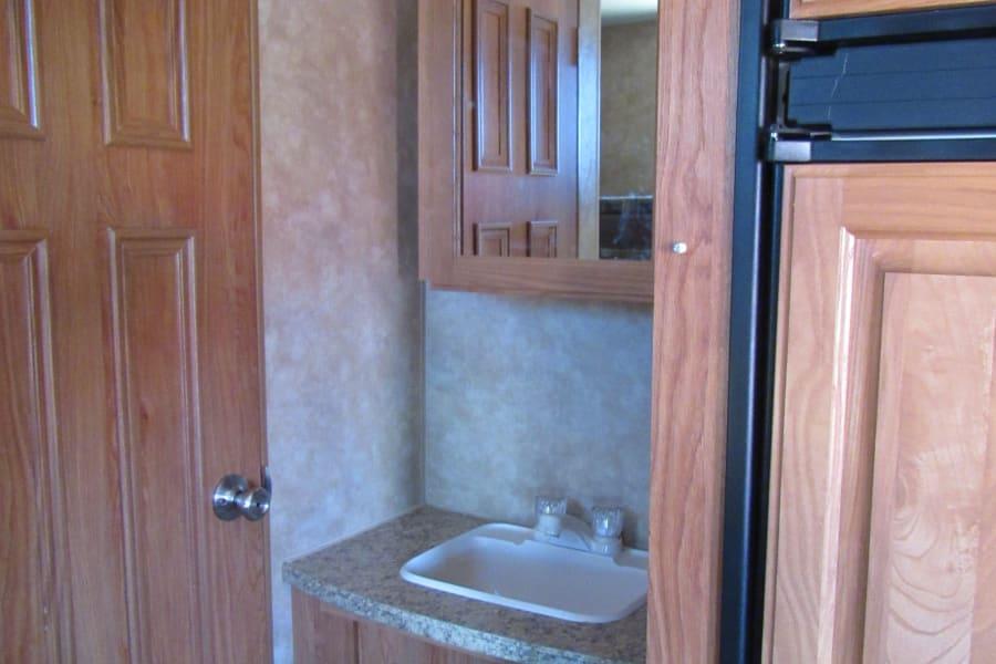 Bathroom sink is outside the bathroom for maximum flexibility.