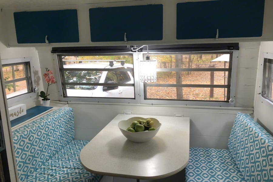 Kitchen table seats 6. Folds down into long double bed. Benches have storage underneath. Plenty of storage for food above