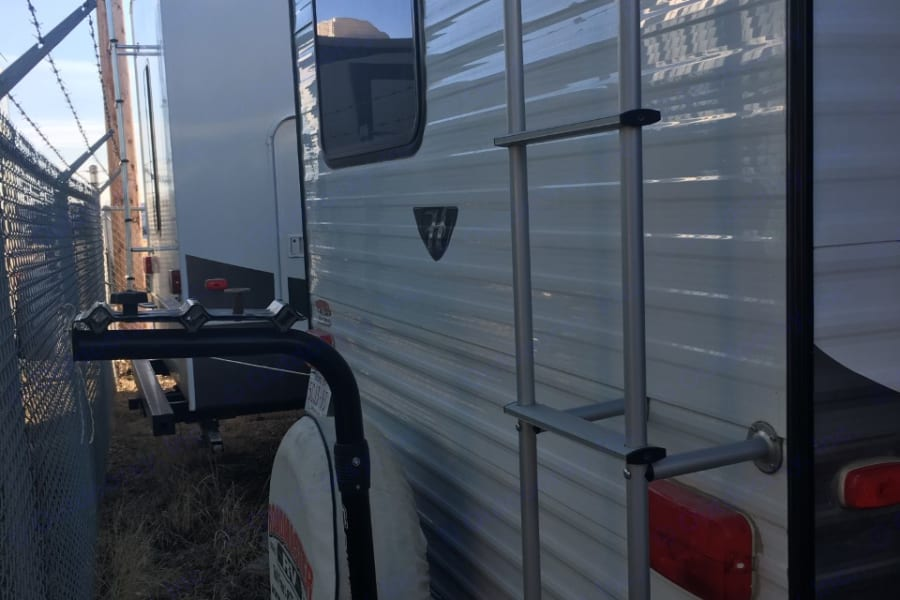 rear of trailer with roof access ladder and bike rack