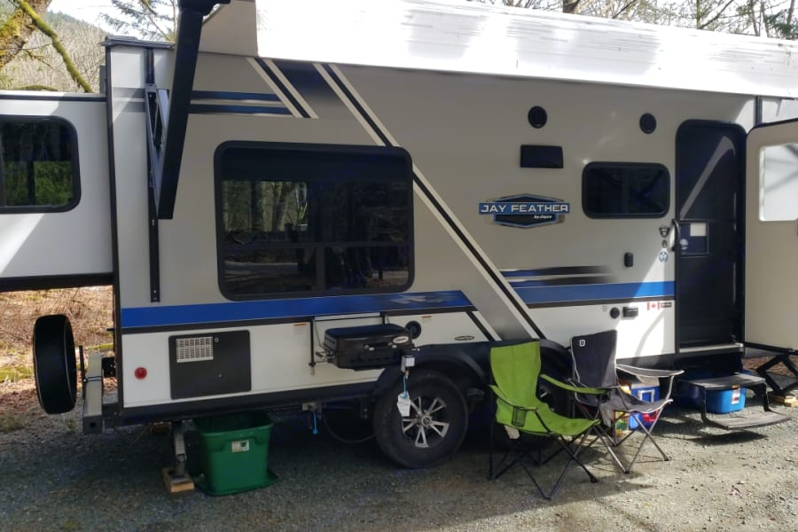 Exterior of trailer. Adjustable awning and Exterior BBQ