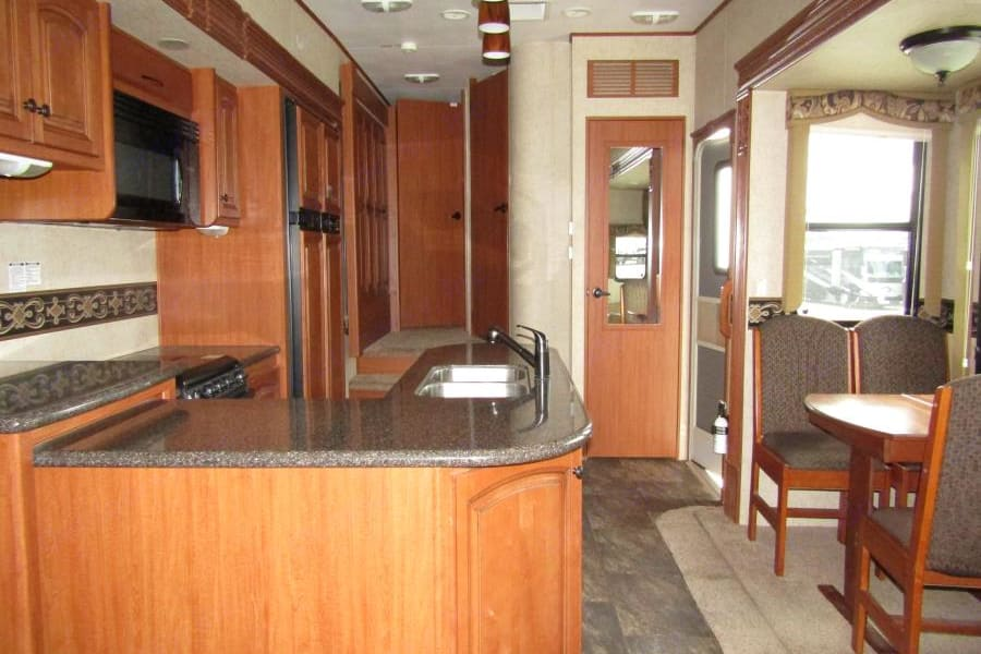 Never thought granite  kitchen space like this would come with a RV!