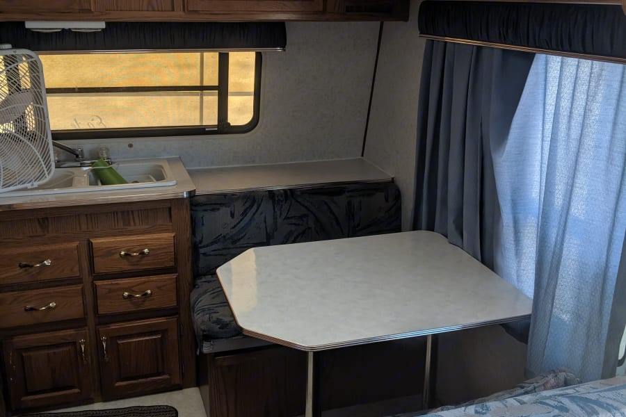 Inside table and kitchen sink with ample storage.
