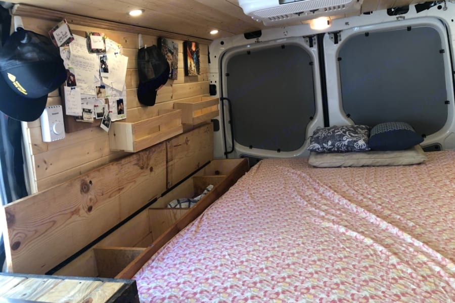 bed with side storage