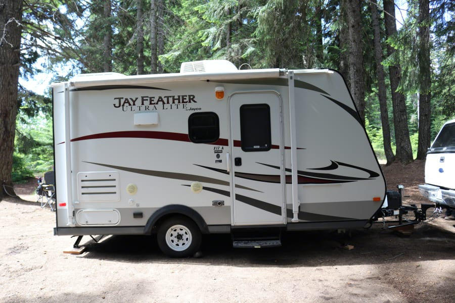 Showing this lightweight trailer with the hybrid beds in the front and back folded up for travel.  Also access to a small storage area in back.  Outside speakers connected to stereo inside.  Electrical Outlet for outside.  Cable/Satellite output.  Also usable awning