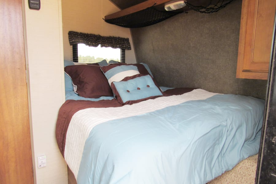 Queen bed with memory foam topper.  Sheets, pillows, and a blanket are included.