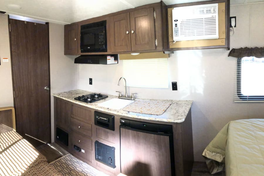 Kitchen Area, 2 stovetop burners + small fridge/freezer.