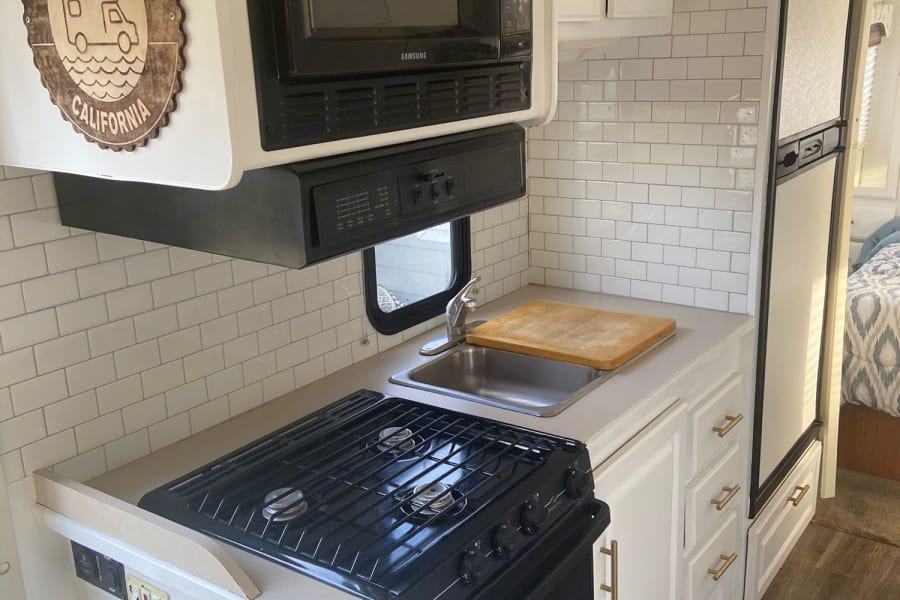 This updated kitchen interior is a bright and happy full kitchen with all the amenities.