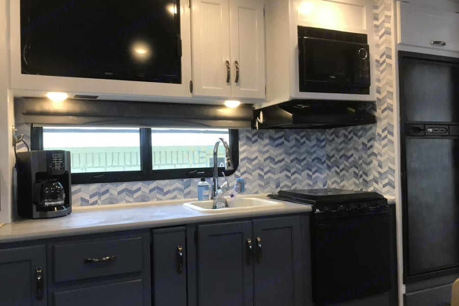 Updated kitchen with flat screen TV directly across from sofa for easy viewing