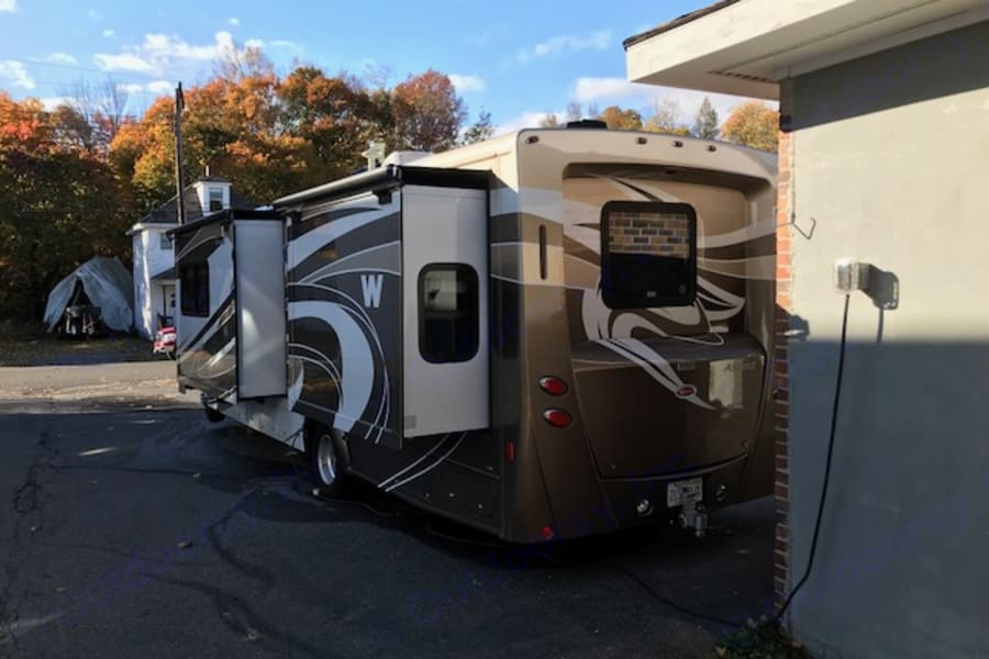 Rear in driveway; garage 30 amp hook up