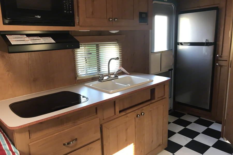 Kitchen area with front door