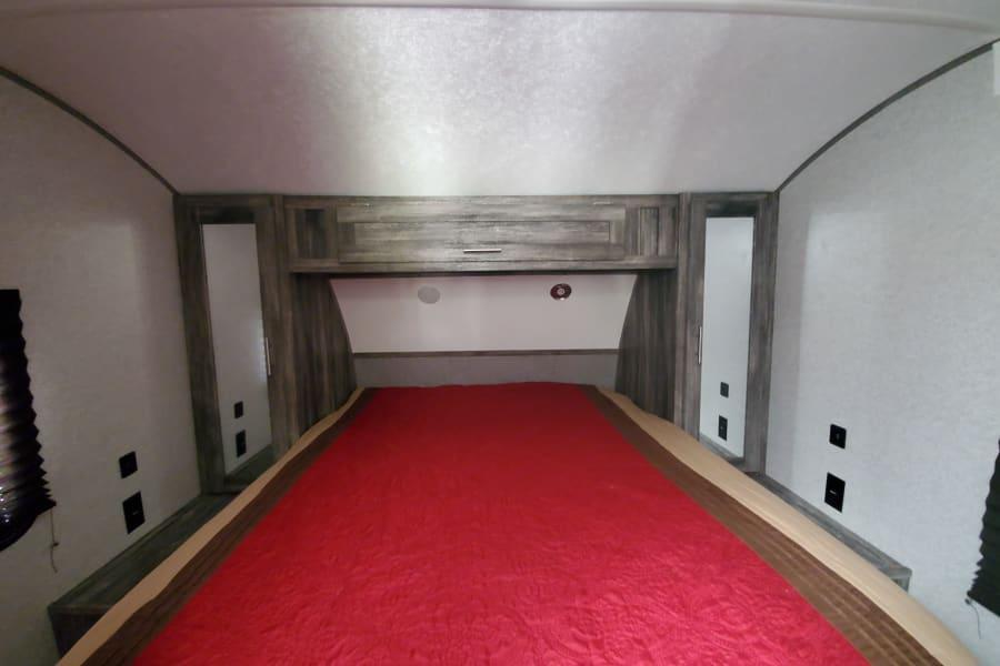 Separate queen size bed. Door closes off bedroom.
