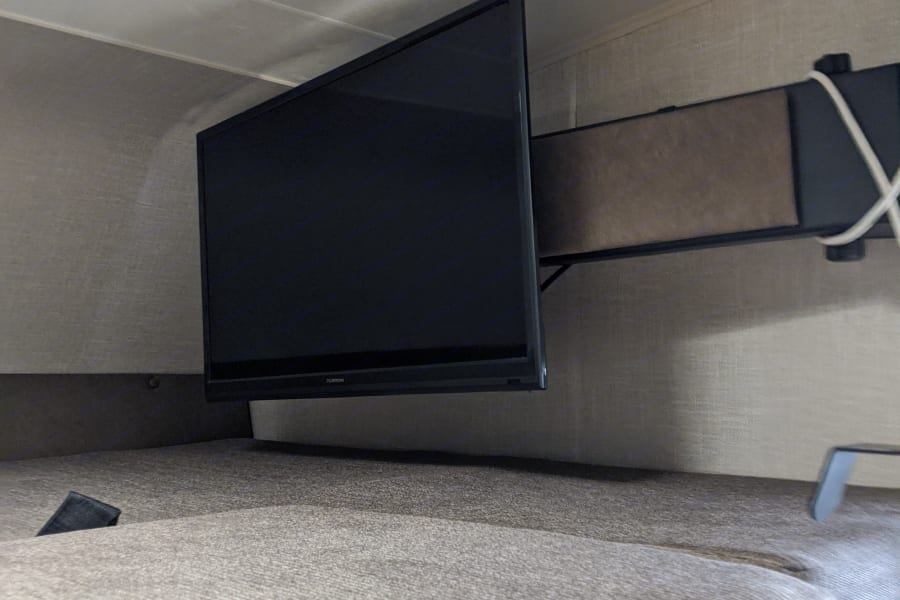 Television with extender arm