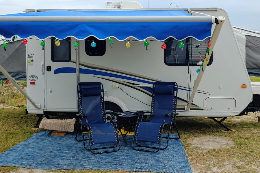 Included in outdoor setup with daily rental fee:  outdoor rug, 2 gravity chairs, camper lights.