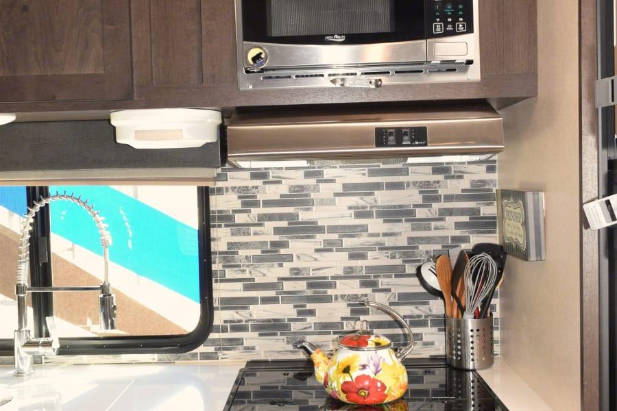 3 burner stove, deep sink, microwave/ vent hood
