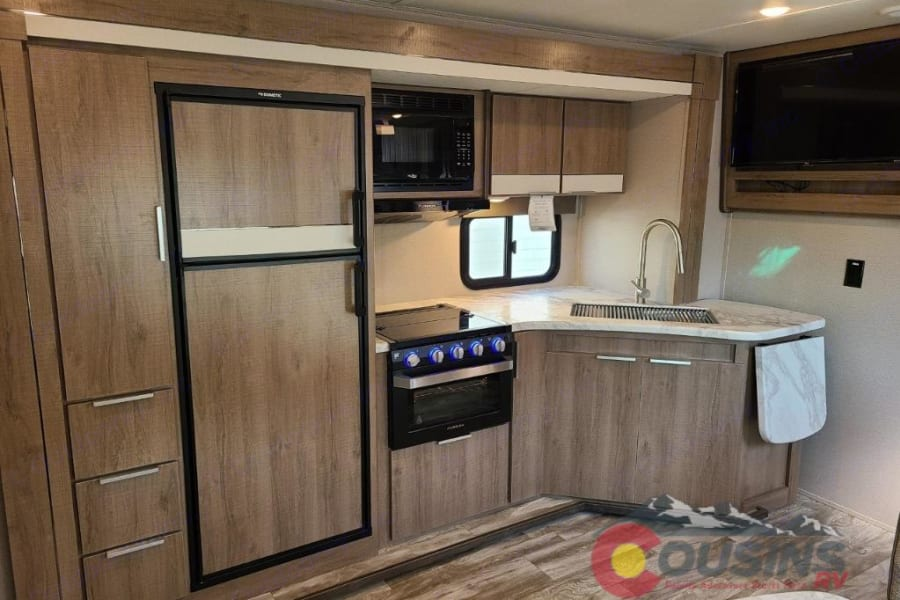 Big Kitchen with 8 cu ft fridge, pantry, stove w/ oven and lots of cabinets.