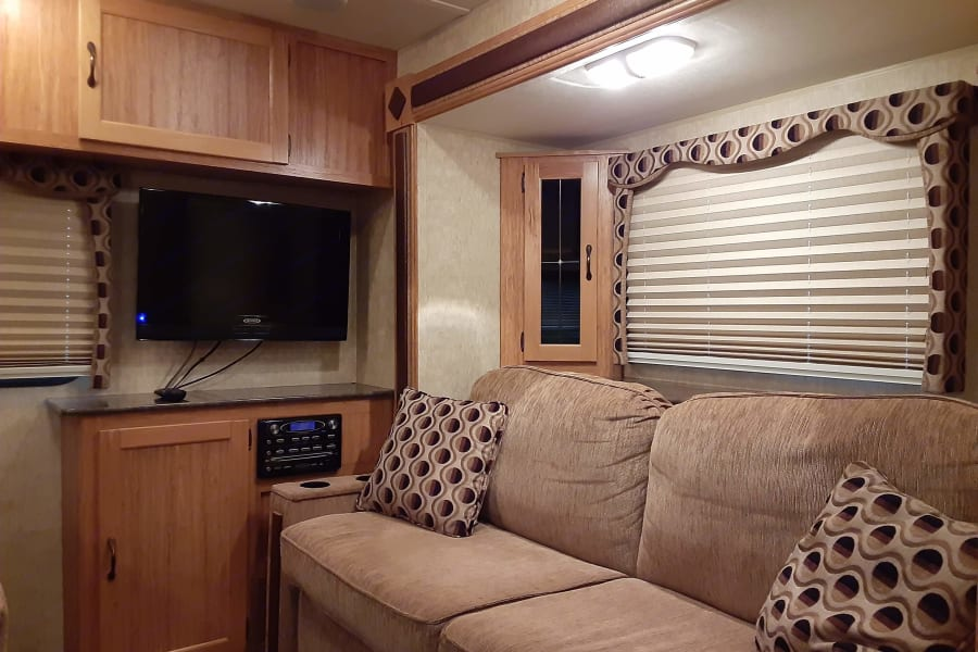 Lounge area with pull-out sofa for additional sleeping area. Entertainment system with CD/DVD and speakers throughout.