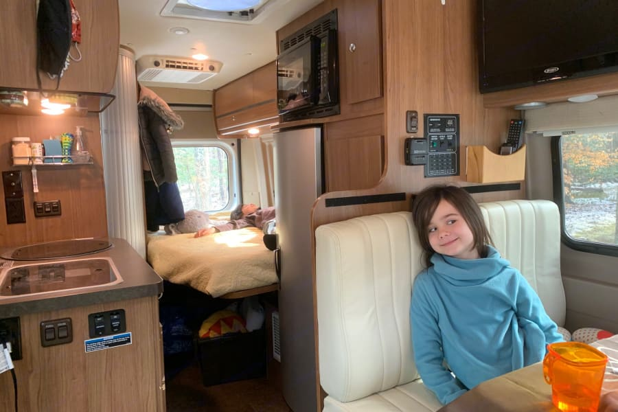 OMG the kids can be in two different locations in the same van! Note under loft bed storage in use in rear