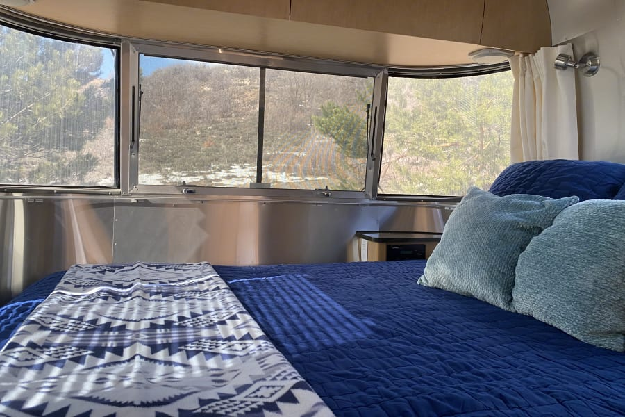 Look at those views with a wrap around window and plenty of light!  There are black out curtains to make sure you get plenty of rest at night.