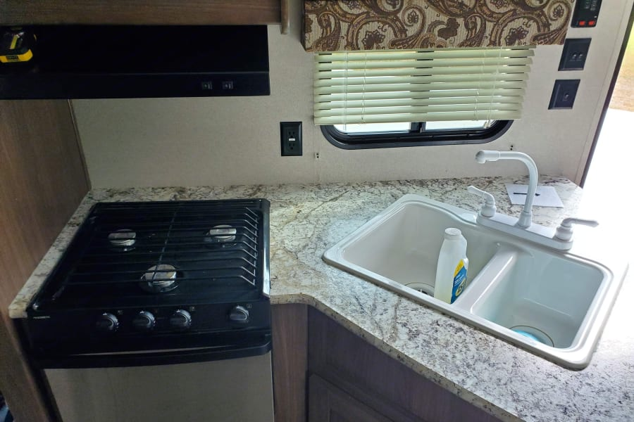 Kitchen sink and gas stove with small oven