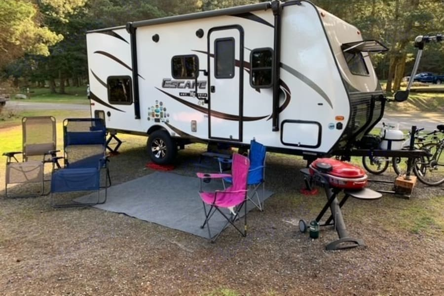 Camper, two recliners, two folding chairs, grill. Optional bike rack.