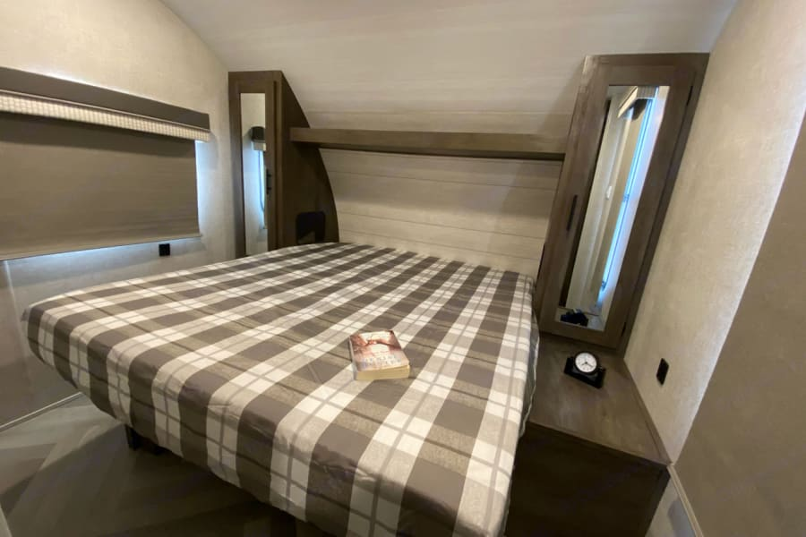 upgraded memory foam queen mattress!  Vanities on each side open up for hanging clothes and bed lifts for extra storage!
